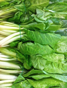 Bietola or Swiss chard bundled for sale in the market.