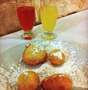 Sweet pettole and homemade limoncello and liquori d'arancio.