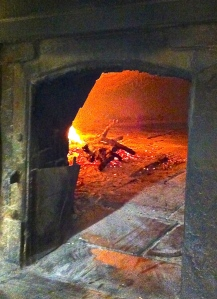 The heat emanating from the Angelini's wood-burning oven warms our hearts.