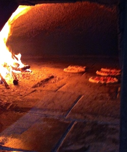 Basking in the glow of the Angelini's wood-burning oven.
