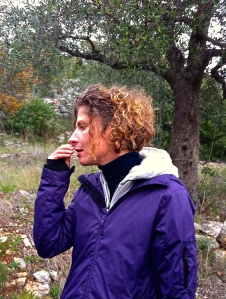 Herbalist Stefania Sicilia identifes a wild sage plant through its aroma.