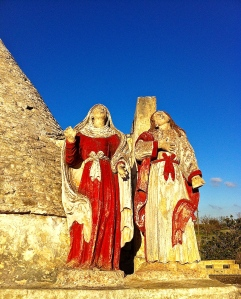 Life-size saints on a Via Ostuni rooftop looking heavenward for divine inspiration.