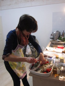 Pina gets to work on the sea bass.
