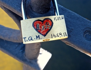 A declaration of love—a couple's initials are inscribed on a padlock locked to a bridge. The key is flung ceremoniously into the river below.