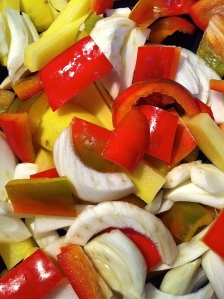 Peppers, fennel and potatoes are chopped and ready for extra virgin olive oil, oregano, salt and pepper.