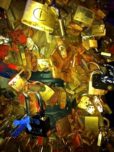 A profusion of padlocks memorializing relationships lost and found adorns a bridge in Lecce, Italy.