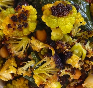 Roasted cauliflower are the final addition to the finished pasta sauce.