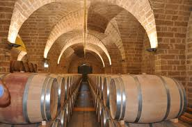 New cellars and barrels at Masseria Li Veli underscore a commitment to quality wines.
