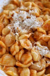 Orecchiette al ragu' with a dusting of grated cacioricotta, the cheese of choice for pasta in Puglia.