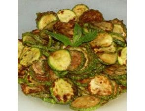 Grilled zucchini are layered with garlic and fresh mint, then drizzled with extra virgin olive oil.
