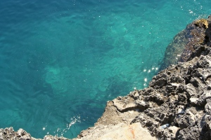 LImestone gives way to the aquamarine waters of the Adriatic in Puglia.