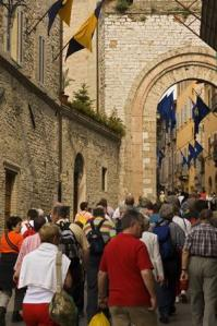 Tourists crowd along a narrow street in Assisi, Perugia. (Photo credit: Photo: James Braund/Lonely Planet as seen in the Sydney Morning Herald, 2/10/08)