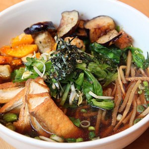 Smoked tofu, sauteed eggplant, raw Asian greens and seaweed  in a caramelized fennel broth represent Portland, Oregon-based Boke Bowl's take on soup noodles.