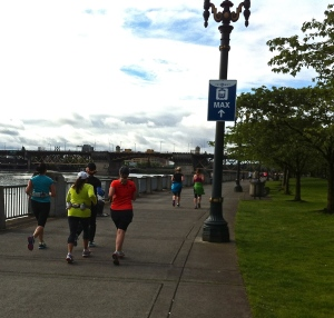Rain or shine, Portland, Oregon runners claim the waterfront for a morning run.