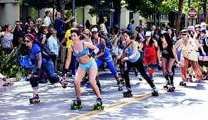 The Santa Cruz Derby Girls skate down Pacific Avenue in Santa Cruz, CA during the annual Santa Cruz Pride Parade.