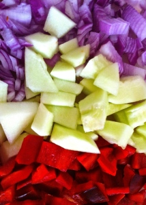 Red onions, cucumber (or cocomero in Puglia) and red peppers roughly chopped and ready for blending with tomatoes for gazpacho.