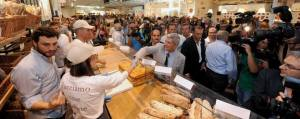 Puglia's governor, Nichi Vendola, greets an Eataly staff member at the food emporium's grand opening (Photo credit: https://www.facebook.com/repubblica.bari).