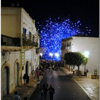The town is bright with fireworks on its patron saint day.