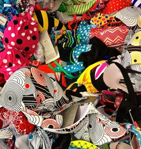 Market stalls sell bathing suits piled high during the summer months.