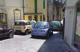 Cars that are parked (per un momento) are the bane of Martinese drivers' existences.