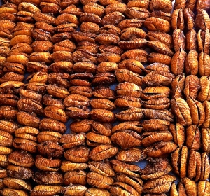 Rows and rows of dried figs are stuffed with a roasted almond, a strip of lemon zest and a small sprig of wild fennel.