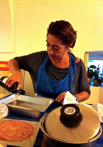 Rosanna uses extra virgin olive oil to prepare the parmigiana pan.