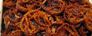 These cartellate are drenched in artisanal vin cotto, a reduced form of Puglia's primitivo wine  that has been concentrated into a barely pourable syrup.