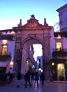As the sun sets in Martina Franca, the baroque details of Porta Santo Stefano are etched against the sky.