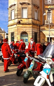 A surfeit of Santas compare notes on their Vespas, the sleigh of choice in Italy.
