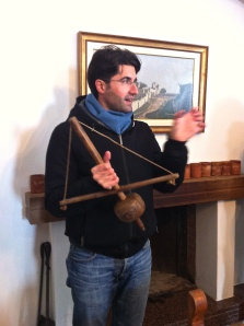 PIerpaolo Palmisano demonstrates an antique drill press used to repair ceramic pottery at his family's masseria.