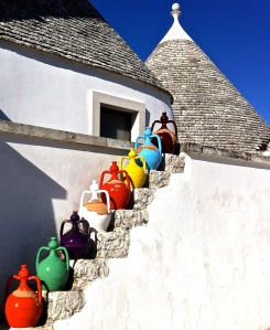Colorful terracotta pots from nearby Grottaglie line the steps to the terrace at Masseria Pilano.