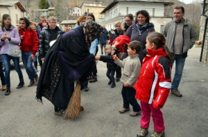 The befana greets children in the piazza, giving them the candy she had saved for the Christ child.