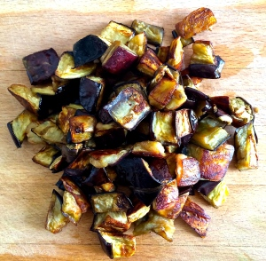 Eggplant cubes have been roasted until they are golden, even a little crispy around the edges.