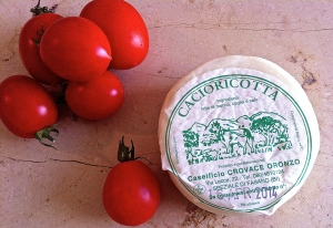 Fresh, seasonal cacioricotta is a slightly aged ricotta that melts beautifully on pasta.
