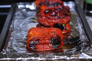 Roast peppers on a foil-lined baking sheet under the broiler until they're blackened on all sides.