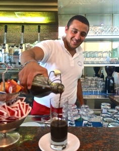Giuseppe serves icy caffè ghiacciato at Super Bar, but only in the summer.