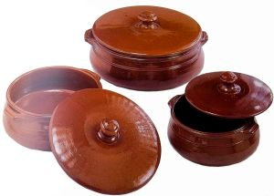 Tiella casseroles are made of terracotta traditionally, but you can use any casserole container that retains heat well and has a depth of about five inches (Photo credit: www.enogastronomiedipuglia.com).