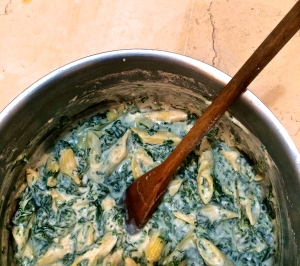 Mix the drained pasta, spinach, béchamel with Gorgonzola, ricotta and extra pasta cooking water to yield a soupy blend. Don't worry if it seems too watery; the pasta absorbs much more liquid than you think. And if you don't make the mix soupy, the resulting baked pasta will be too dry.