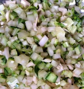 Diced Swiss chard stems are sauteed with onions and leeks to add body and flavor to the gratin.