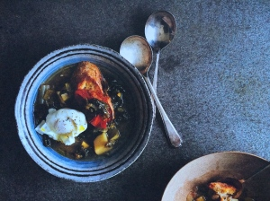 The finished soup is served over toasted country bread with a poached egg on top. The egg enriches the brothy soup; the bread absorbs it all.