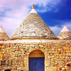 Puglia's stone dwellings, called trulli, are unmistakable with their cone-shaped rooflines and pointy pinnacle dotting the landscape here.