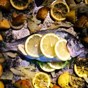 Orata, or gilt-head bream, is a beautiful fish when roasted, Puglises-style, over thinly-sliced potatoes with leccino olives and loads of extra virgin olive oil.
